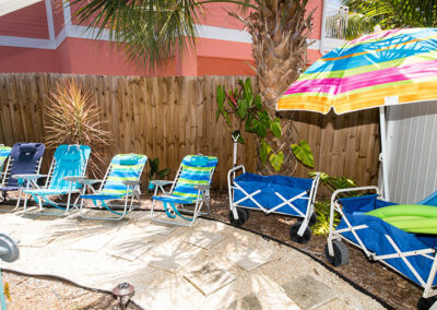 Anna-Maria-Island-Harbor-Lane-Court-Rental-lounge-chairs-by-the-pool