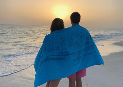 Anna-Maria-Island-Harbor-Lane-Court-Rental-towel-in-the-sunset