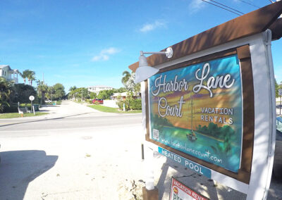 Slide Show Anna-Maria-Island-Harbor-Lane-Court-Rental-sign-2