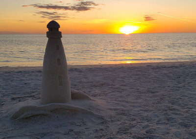 Slide Show Anna-Maria-Island-sunset-with-sand-lighthouse
