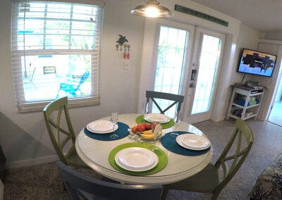 Unit-4-Dining-table-with-court-yard-and-swiming-pool-view-from-kitchen